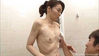 Small boobs Japanese chick Asou Chiharu drops on the brush knees to with no holds barred