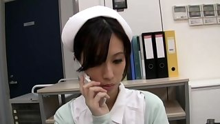 Horny Japanese nurse Anna Noma moans while playing with a dildo