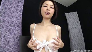 Japanese doll in crotchless pantyhose dildoing her fuck hole